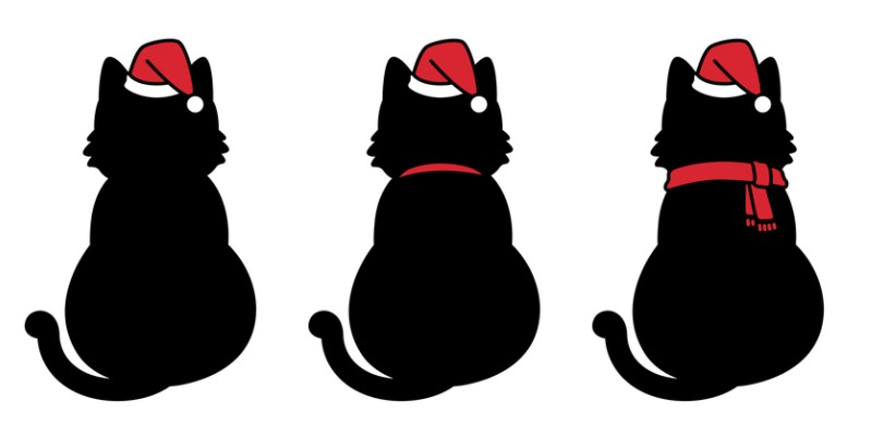 Cats back profile wearing santa hats